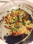 Prawns saute in olive oil, garlic and garnished with chopped coriander leaves.